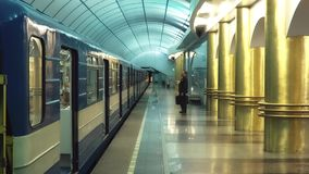Businessman Walks Into A Underground Carriage. Slow motion shot of a businessman with a suitcase in hand walks into a underground carriage stock video footage