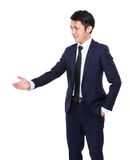 Businessman want to have a hand shake Stock Photos