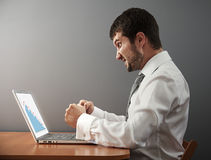Businessman wants to break his laptop Royalty Free Stock Photography