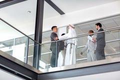 Businessman warmly greet Arabian partner in hall. Multiethnic business partners warmly greet in company hall royalty free stock photos