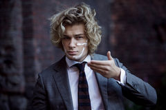 Businessman warrior. Young man makes war paint on Stock Photography