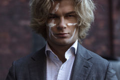 Businessman warrior. Young man makes war paint on Royalty Free Stock Photos