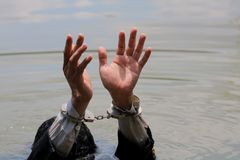 Businessman was arrested by handcuffs and drowning. In water with copyspace Royalty Free Stock Images