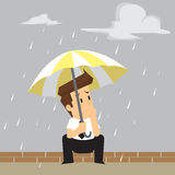 Businessman was caught in the rain Royalty Free Stock Photos