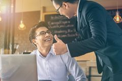 Businessman was given a thumbs-up and compliments from his boss. Who successfully worked stock photography
