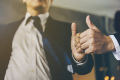 Businessman was given a thumbs-up and compliments from his boss stock photo
