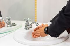 Businessman washing hands Royalty Free Stock Photography
