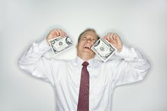 Businessman wasting money Stock Photo