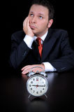 Businessman is wasting time Royalty Free Stock Images