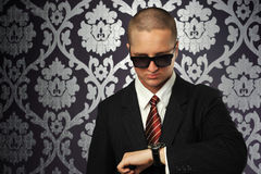 The businessman watch the clocks. The young businessman watch the clocks Stock Photography