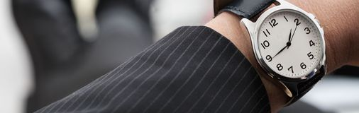 Businessman with a watch Stock Image