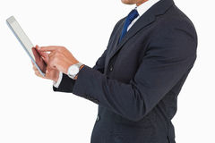 Businessman with watch using tablet pc Royalty Free Stock Photo