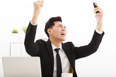 Businessman watching the smart phone in  office Stock Photo