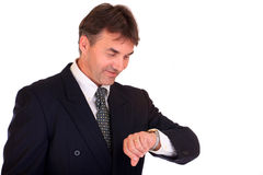 Businessman watching time Stock Photos