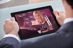 Businessman watching video Stock Images