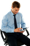 Businessman watching videos on tablet pc Royalty Free Stock Photo