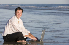 Businessman in Water at Beach Stock Photo
