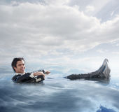 Businessman in the water royalty free stock photography