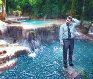 Businessman in the waterfall. Troubled businessman standing in the waterfall Stock Photography