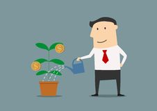 Businessman watering a money plant Royalty Free Stock Image
