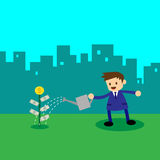 Businessman watering money plant Stock Photo