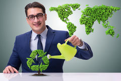 The businessman watering plan in recycling concept. Businessman watering plan in recycling concept Royalty Free Stock Photos