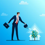 The businessman waters a monetary tree Royalty Free Stock Images