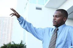 Businessman waving Royalty Free Stock Photos