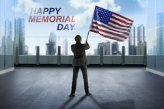Businessman waving American flag for happy memorial day. With blue sky background Royalty Free Stock Photography