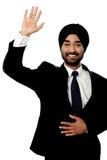 Businessman waving hi to his colleague Stock Photo