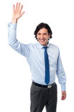 Businessman waving hi to his colleague Stock Photo