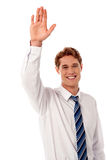 Businessman waving hi to his colleague Royalty Free Stock Photo
