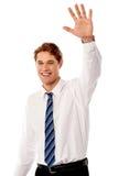 Businessman waving hi to his colleague Royalty Free Stock Photos