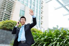 Businessman waving his hand Royalty Free Stock Images