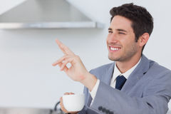 Businessman waving at someone in the kitchen Royalty Free Stock Images