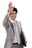 A businessman waving Royalty Free Stock Image