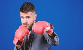 Businessman wear boxing gloves. Best criminal defense lawyer strategies. Tactics proven to work. Attack and defense. Concept. Successful businessman. Criminal stock photography