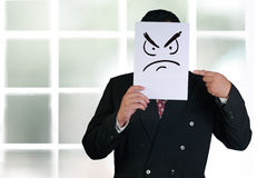 Businessman Wearing Angry Face Mask Stock Photos