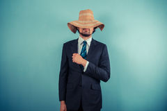 Businessman wearing a beach hat Stock Images