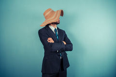 Businessman wearing a beach hat Royalty Free Stock Images