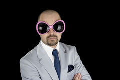 Businessman wearing big funky pink glasses Royalty Free Stock Images