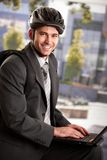 Businessman wearing bike helmet Stock Photos