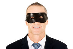 Businessman wearing black eye mask Stock Image