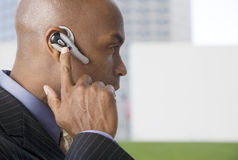 A businessman wearing a bluetooth headset Stock Image