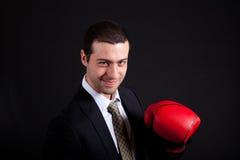 Businessman wearing boxe gloves Royalty Free Stock Photos