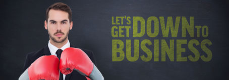 Businessman wearing boxing gloves. Beside buzz words stock image