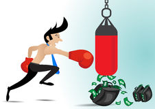 Businessman wearing boxing gloves and have money in punching the punch bag.  Royalty Free Stock Photography