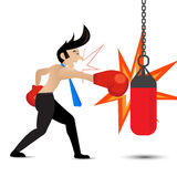 Businessman wearing boxing gloves and punching the punch bag Stock Photo