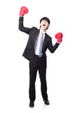 Businessman wearing boxing gloves in a victory pose and raise hi. Young handsome Businessman wearing boxing gloves in a victory pose and raise his arms in full Stock Photos