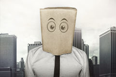 Businessman wearing brown paper bag on head Royalty Free Stock Photo